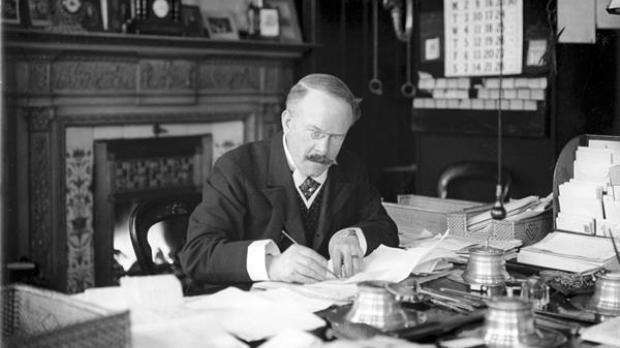 Dr. Barnardo at desk
